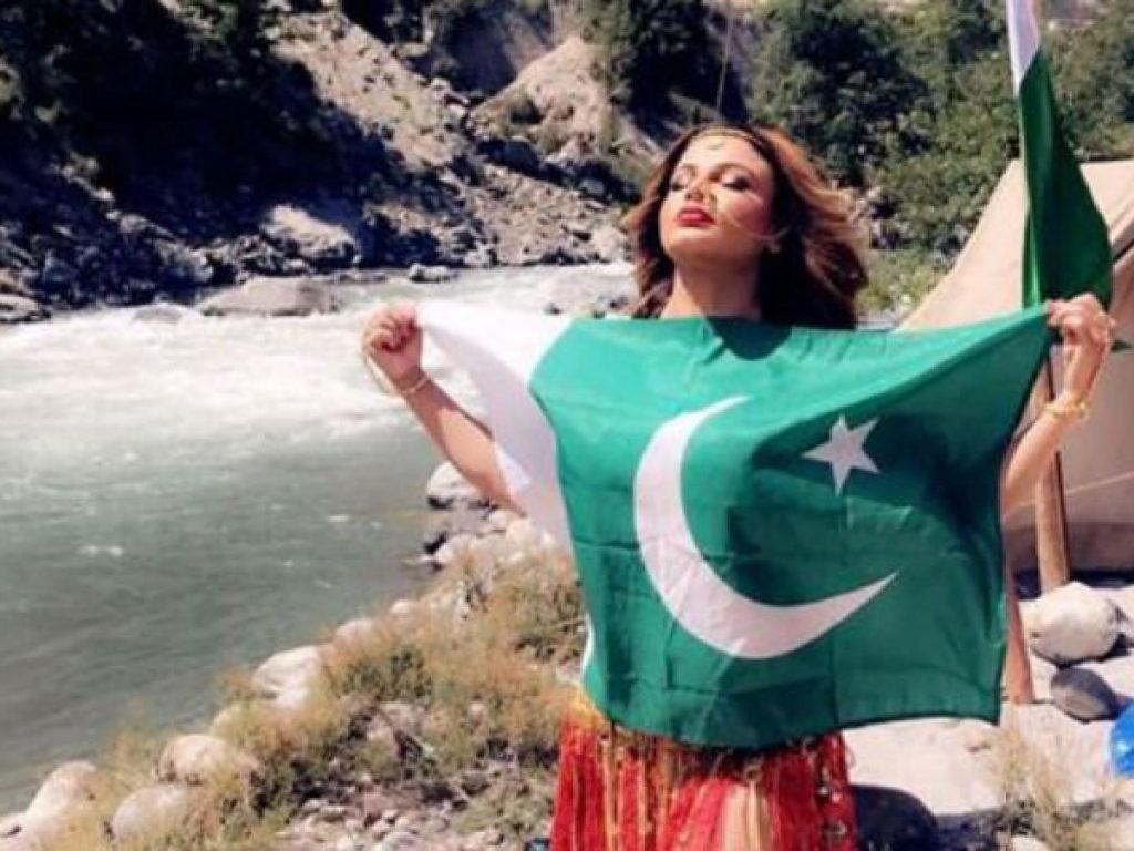 Indian Actress Rakhi Sawant Poses With Pakistan Flag